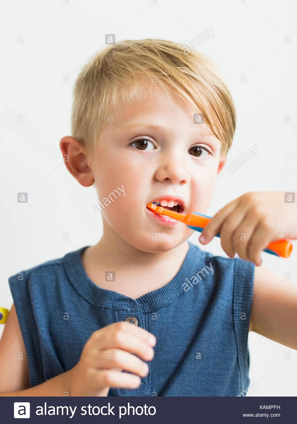 Little boy (2-3) brushing teeth - Stock Image