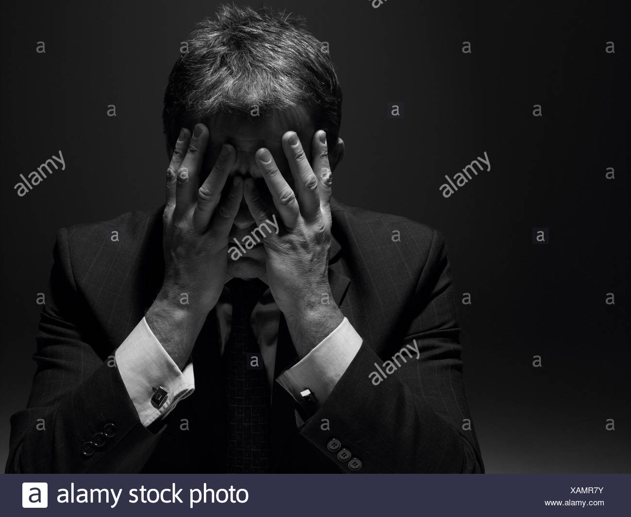 doubts,worry,stress,struggle,businessman,burnout - Stock Image