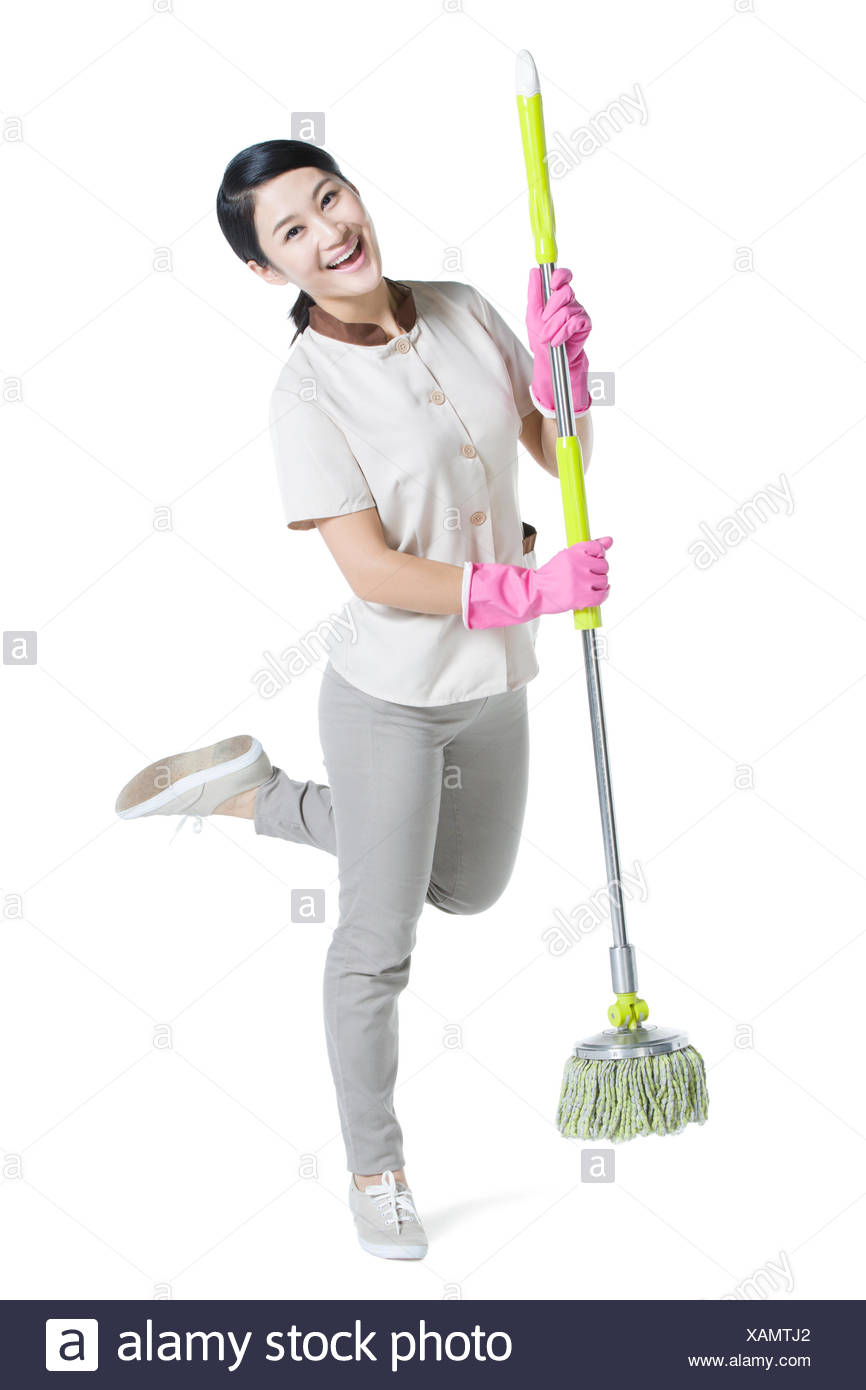 Cleaner holding a mop - Stock Image