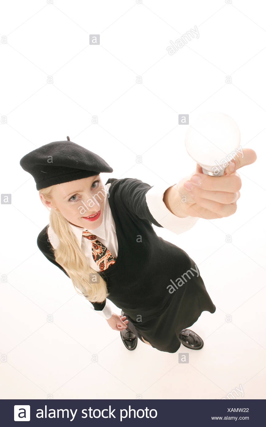 young blond woman holding lightbulb Stock Photo