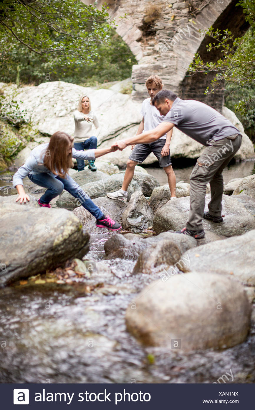 Family in a stream - Stock Image