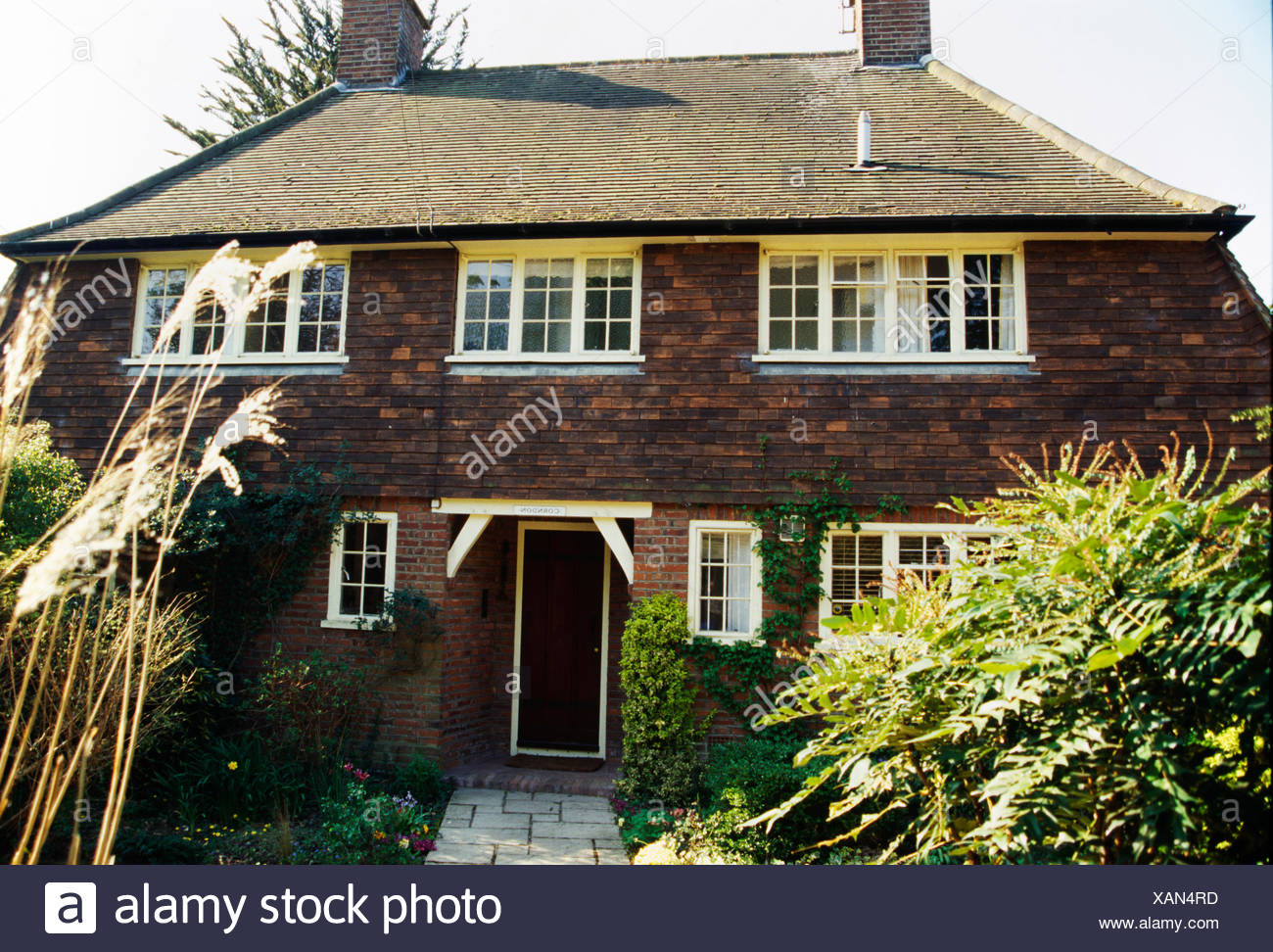 Traditional brick-built Thirties house in the country - Stock Image
