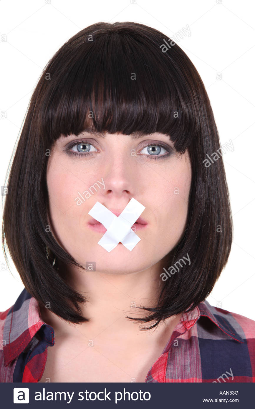woman with a scotch tape on her mouth Stock Photo