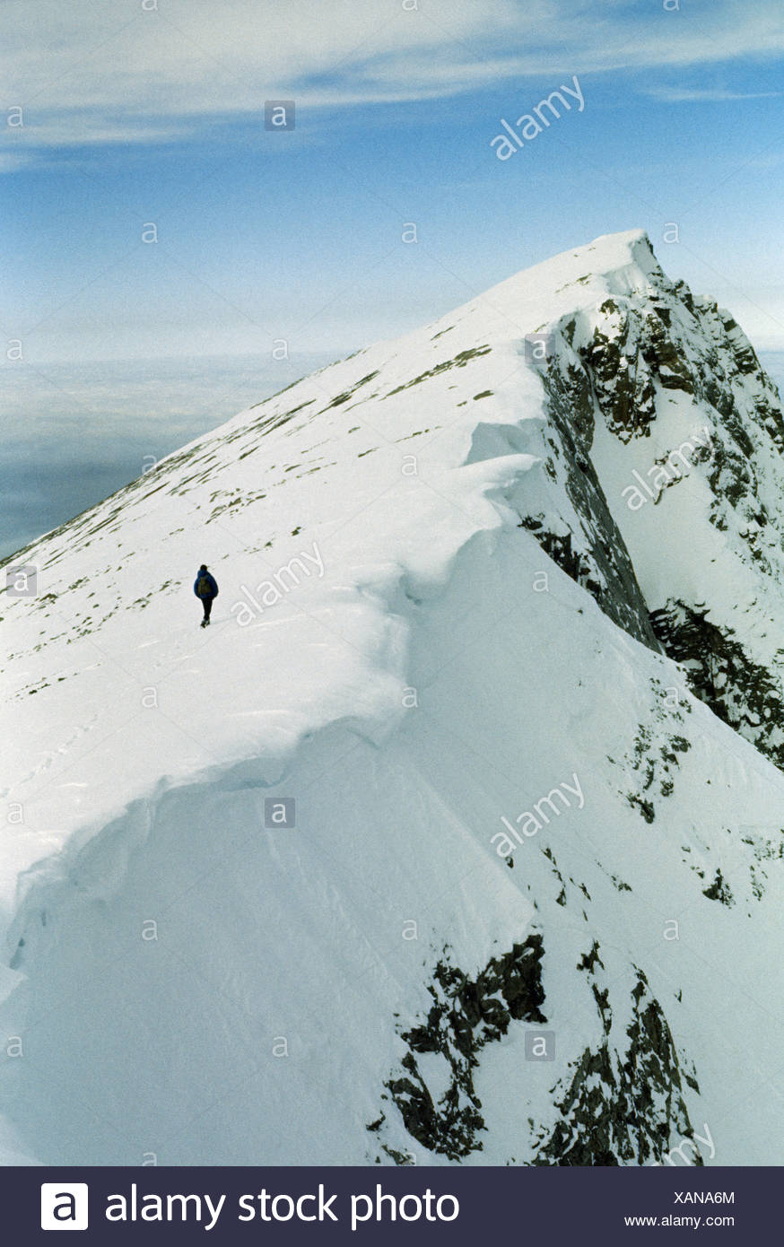 Climber approaches false summit of Greek home to mythical gods. - Stock Image