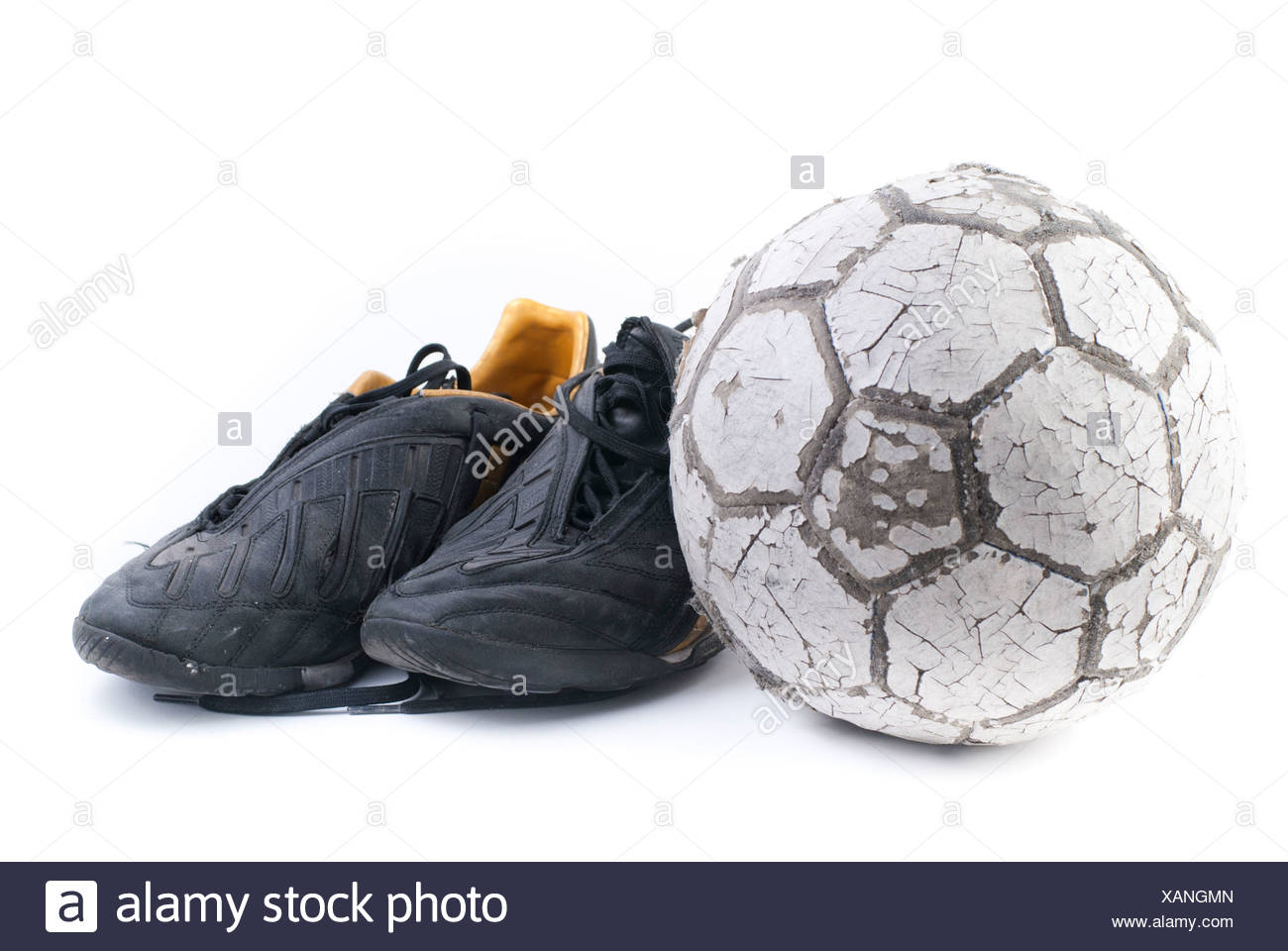 df92d393f Soccer ball with two old black soccer shoes Stock Photo: 281986565 ...