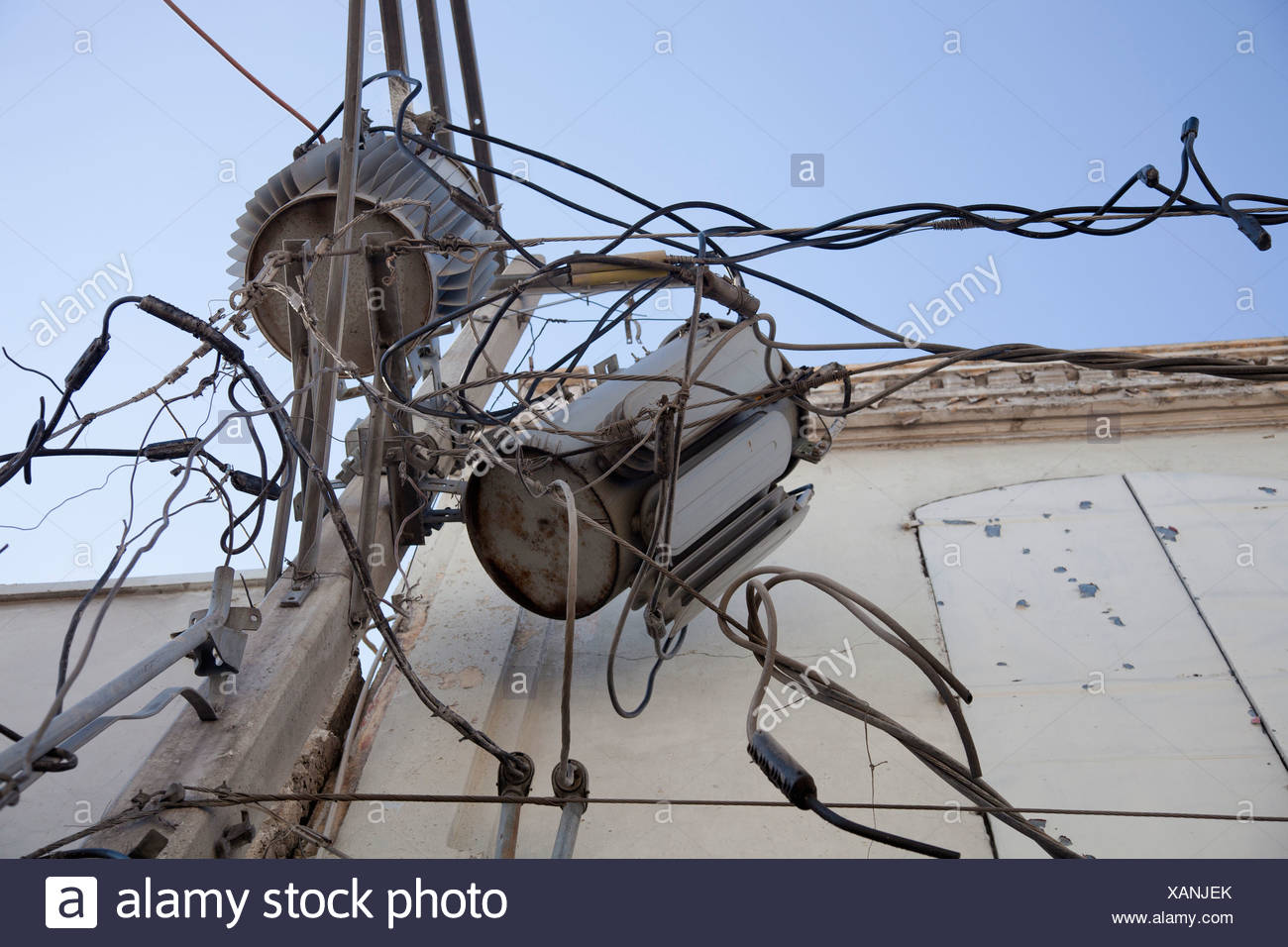 damaged electrical wires and transformers after the earthquake; port Electrical Receptacle Types