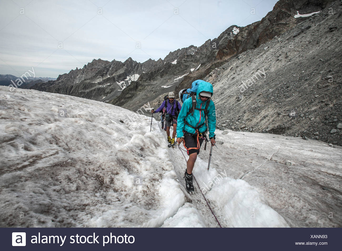 Series on trekking 'des Ecrins', Middle aged people hiking in the Glacier Blanc, france, alps - Stock Image