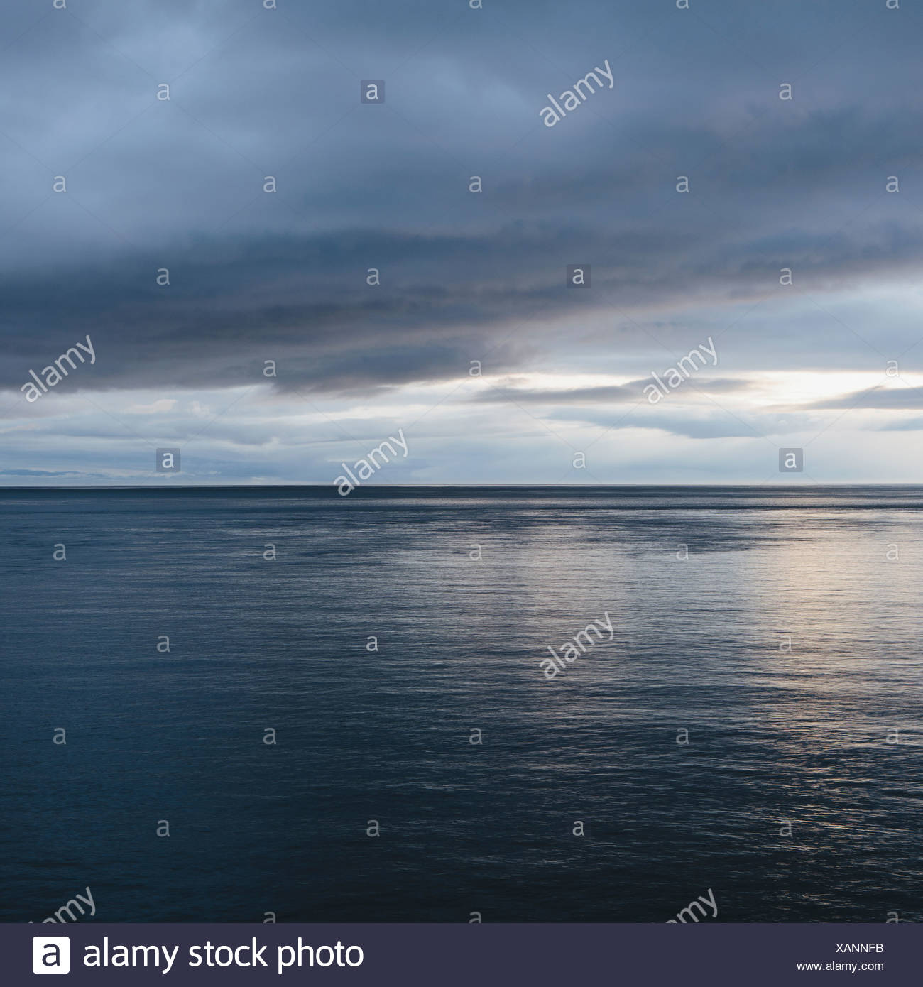 The sea and sky over Puget Sound in Washington USA The horizon with light cloud layers above Stock Photo