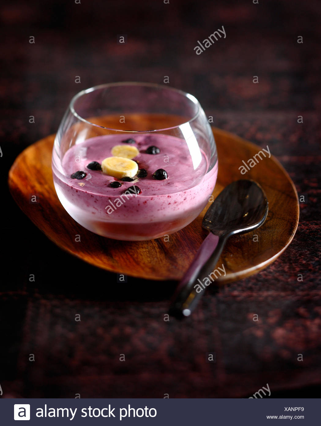 Banana-bilberry smoothie with maple syrup - Stock Image
