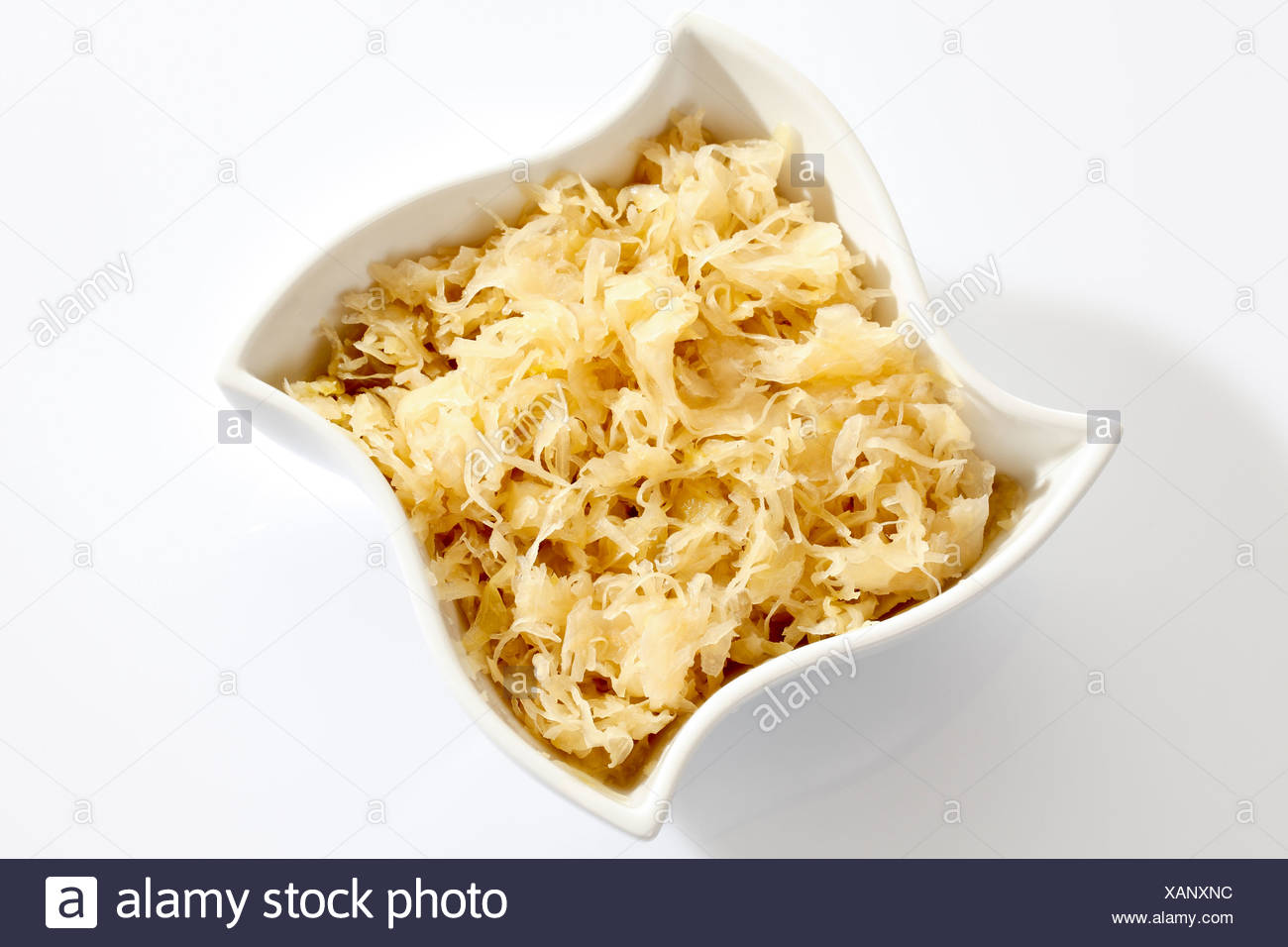 Sauerkraut from a can in a white porcelain bowl Stock Photo