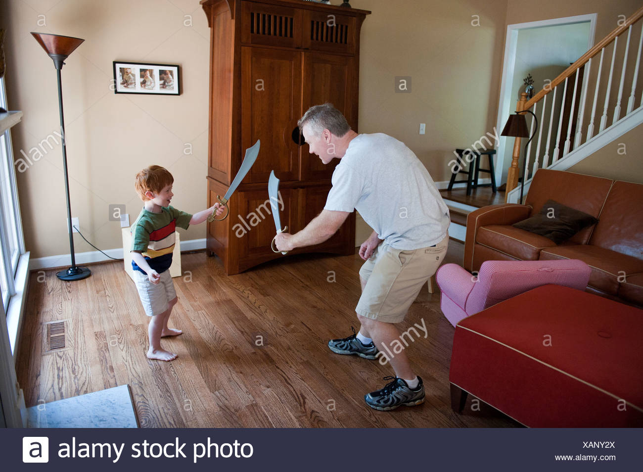 A father and son pretend to be pirates at their home in Marietta, GA. - Stock Image