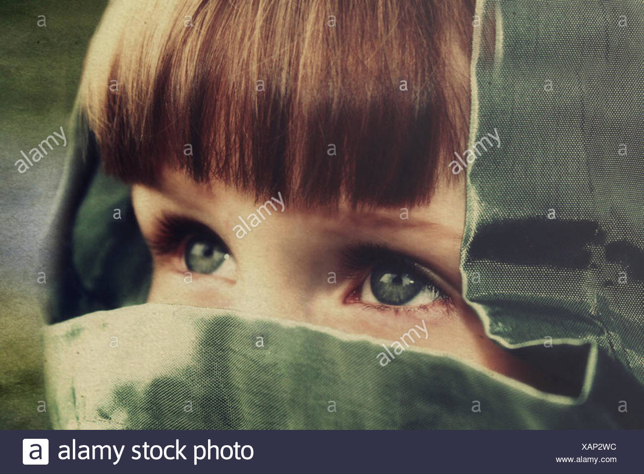 Close-up of girl wearing hood - Stock Image