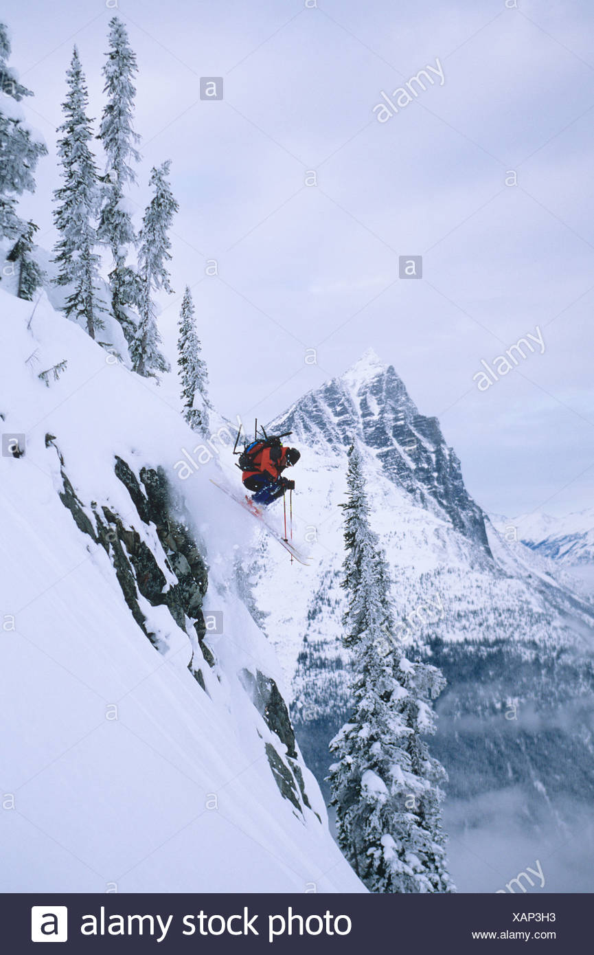 Skier skiing in backcountry at Rogers Pass, Glacier National Park, near Revelstoke, British Columbia, Canada. - Stock Image