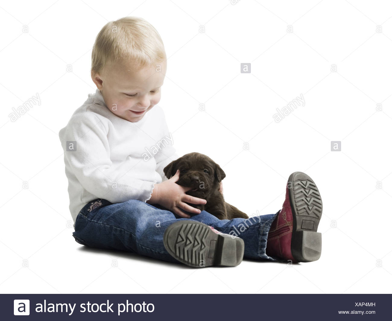 child with puppy - Stock Image