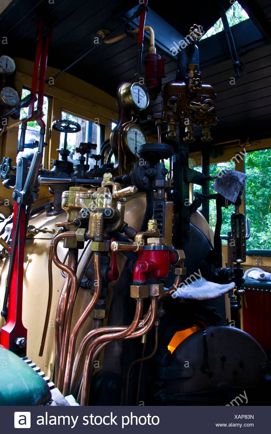 The boiler room and calliper breaks on a restored antique steam train. - Stock Image