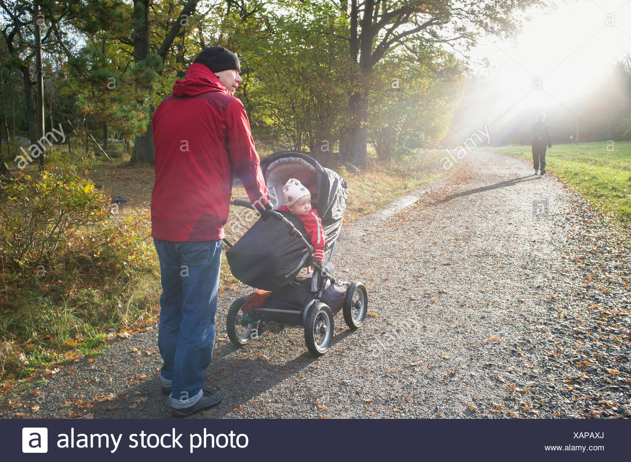Sweden, Sodermanland, Nacka, man with son (12-17 months) walking in park Stock Photo