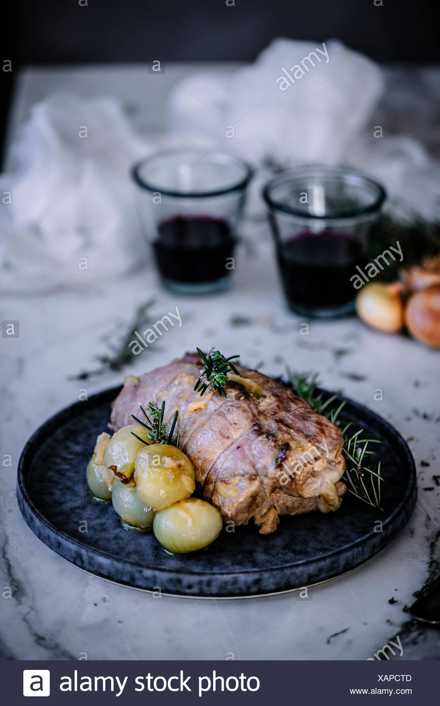 Iberian traditional roast pork, cooked with stuffed cheese and quince. - Stock Image