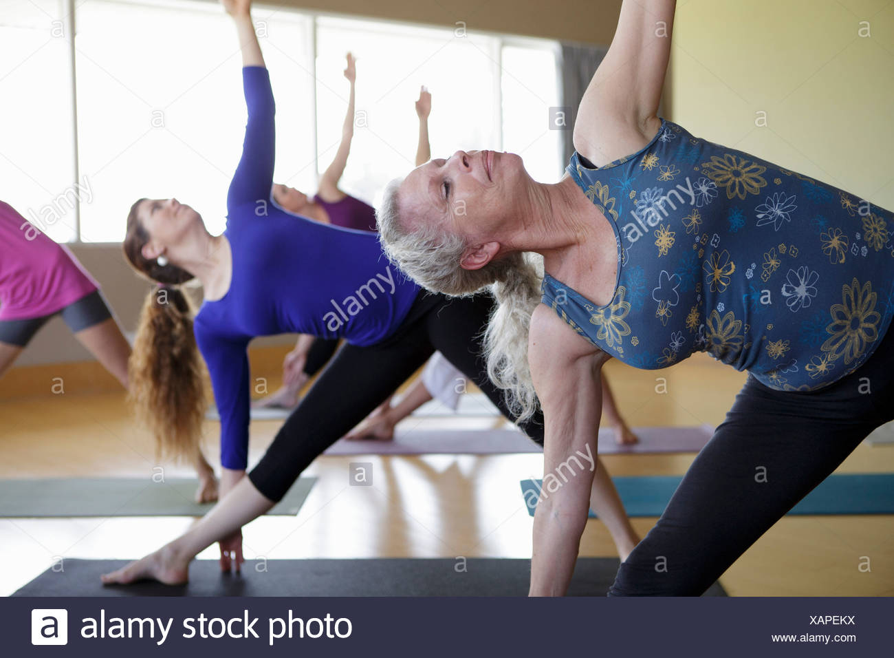 Females stretching yoga class - Stock Image