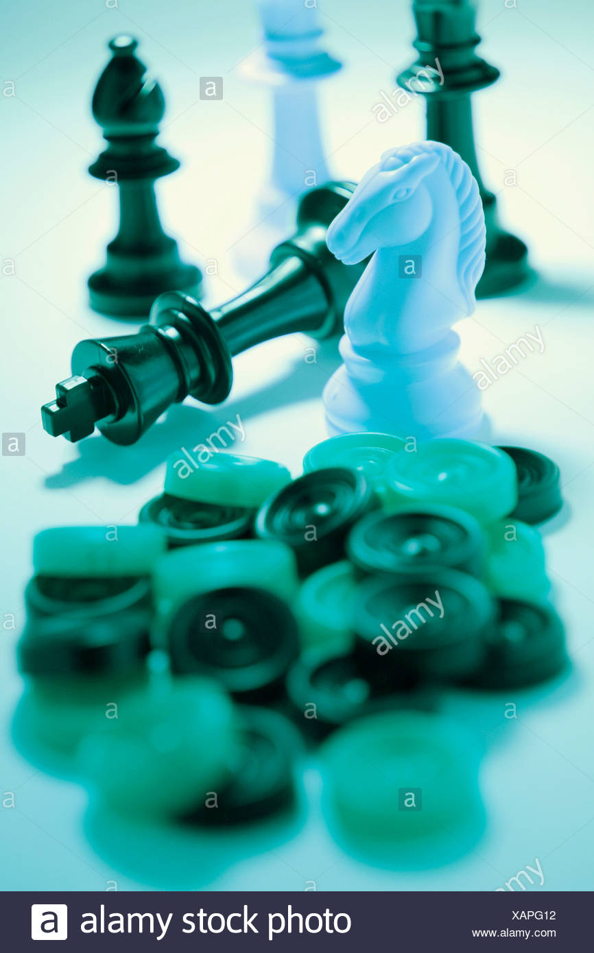 Chess and checkers, draughts pieces - Stock Image