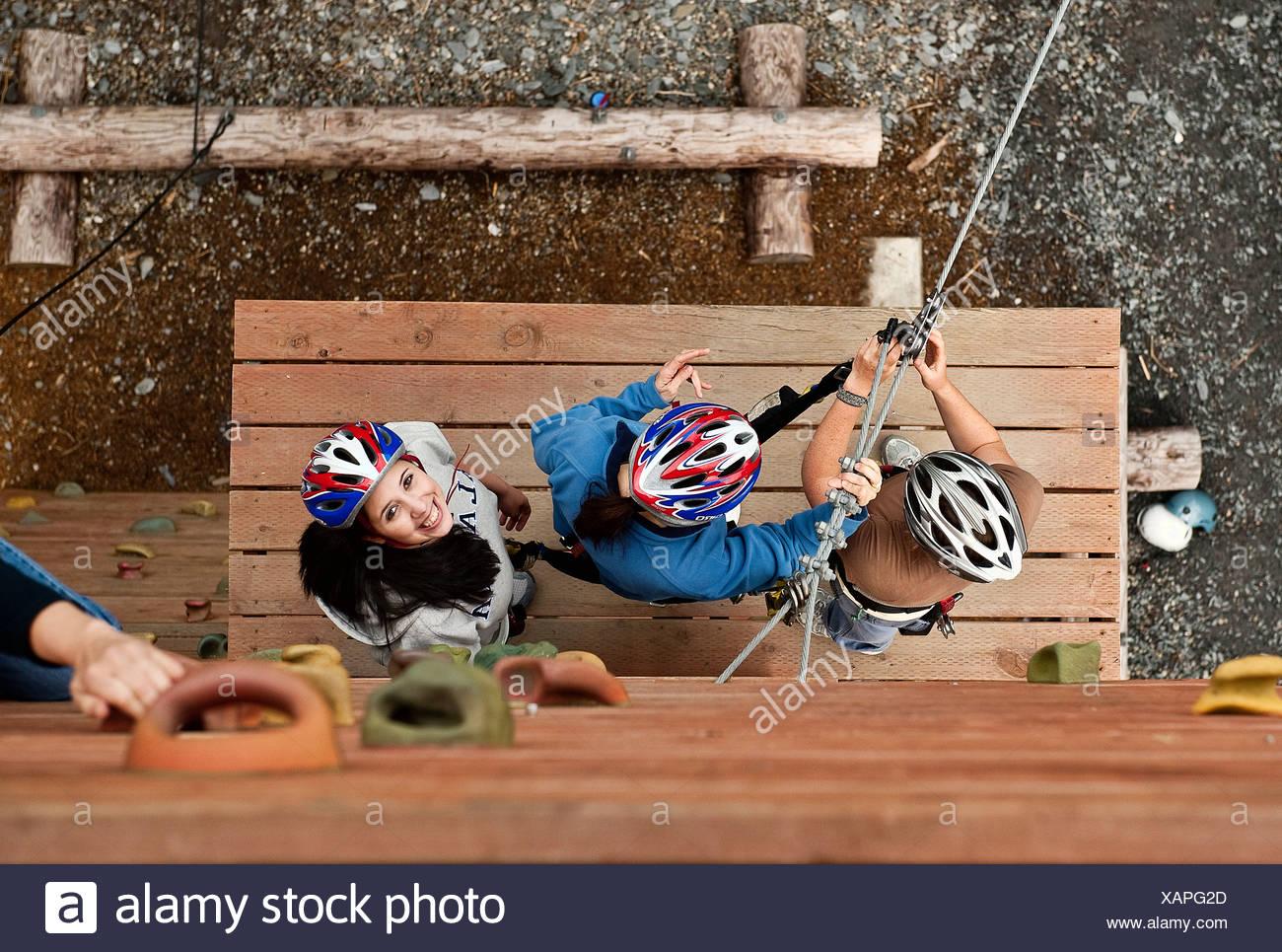 Woman prepares for a zipline adventure through the trees, Ketchikan, AK, Alaska, USA - Stock Image