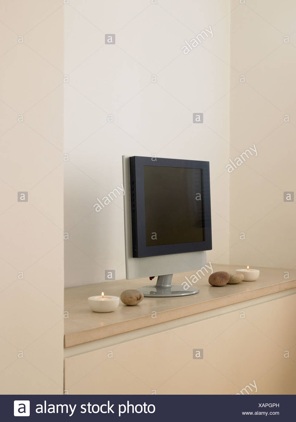 Television screen on shelf - Stock Image