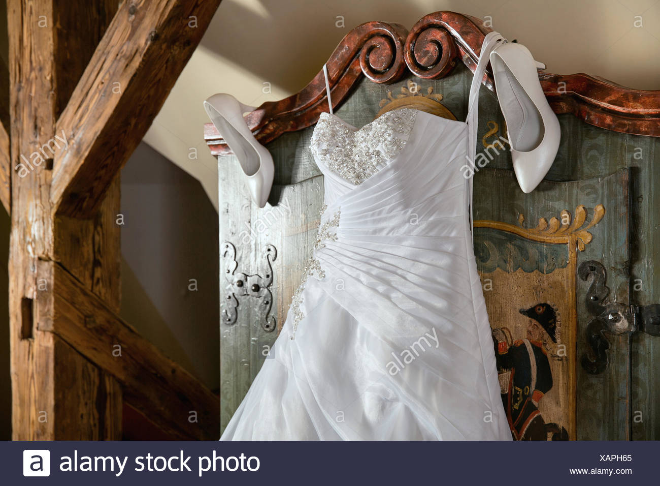 Elegant white wedding dress with boots - Stock Image