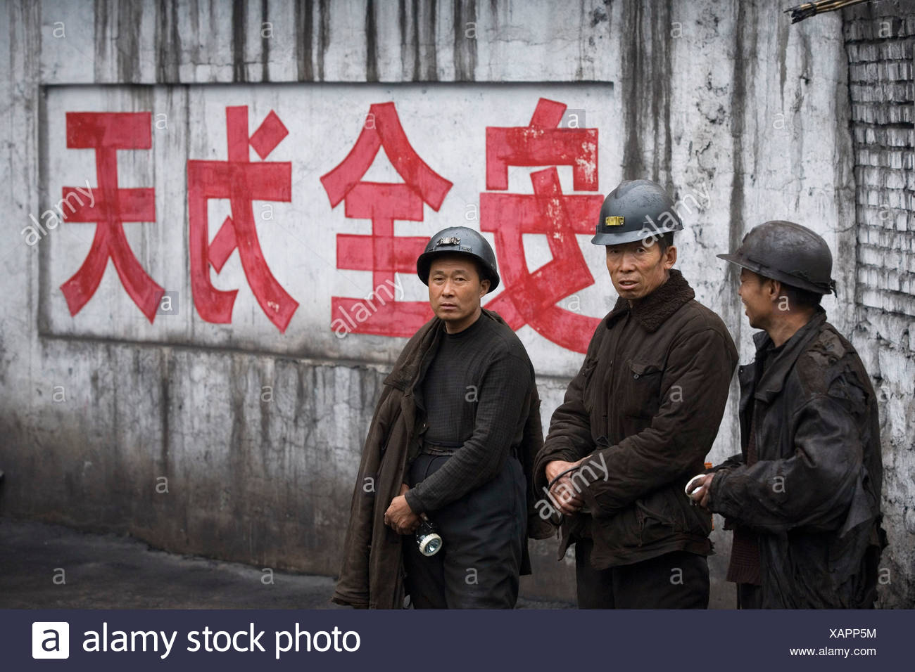 Workers chat at a chinese coal mine, Liulin, Shanxi, China. Stock Photo