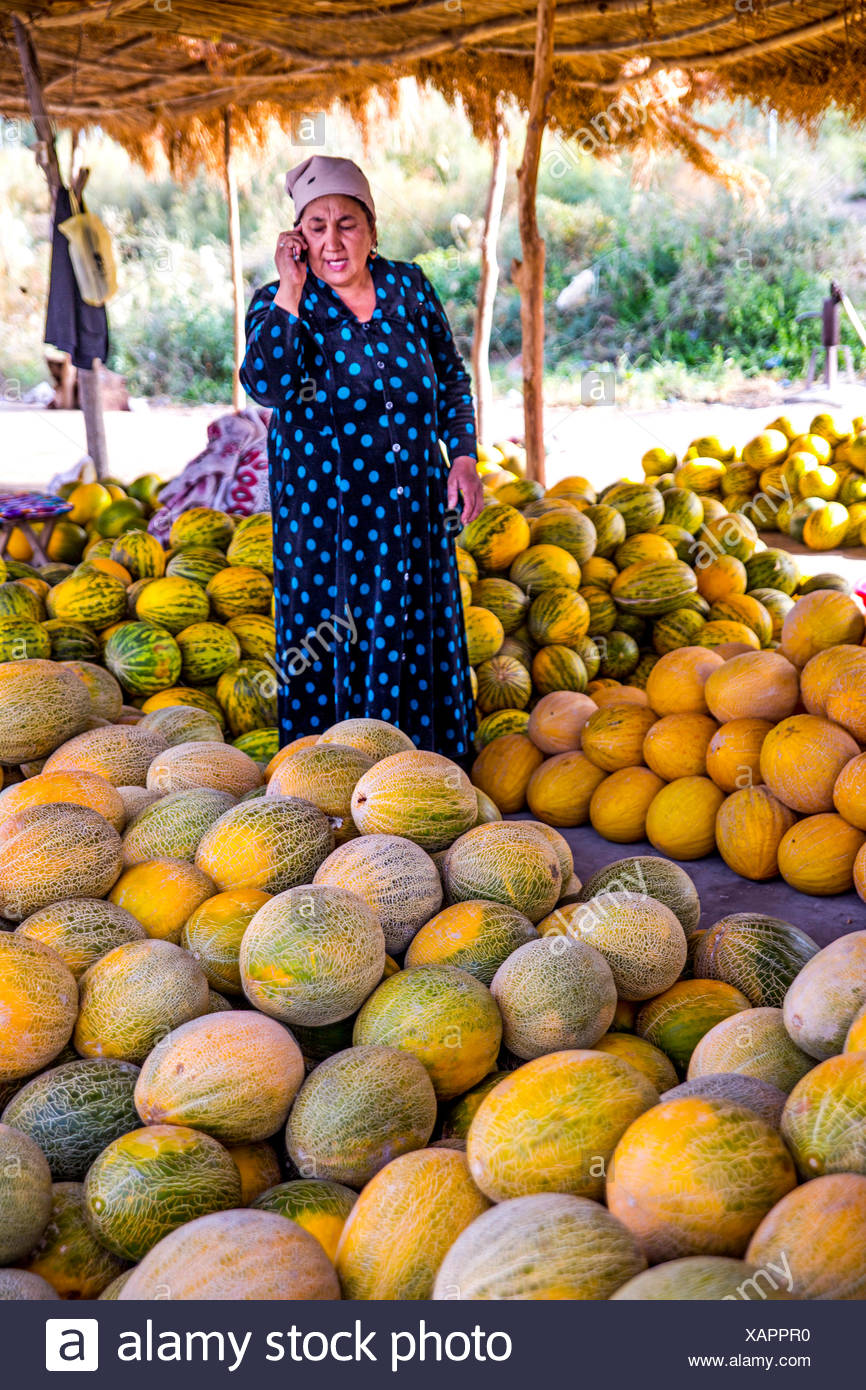 geography / travel, Uzbekistan, people, trader with melons at market, Additional-Rights-Clearance-Info-Not-Available - Stock Image