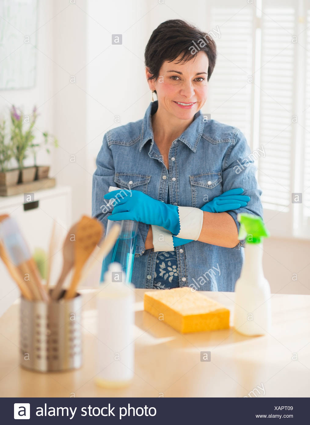 Portrait Of Mature Woman Cleaning Kitchen Stock Photo 282014217