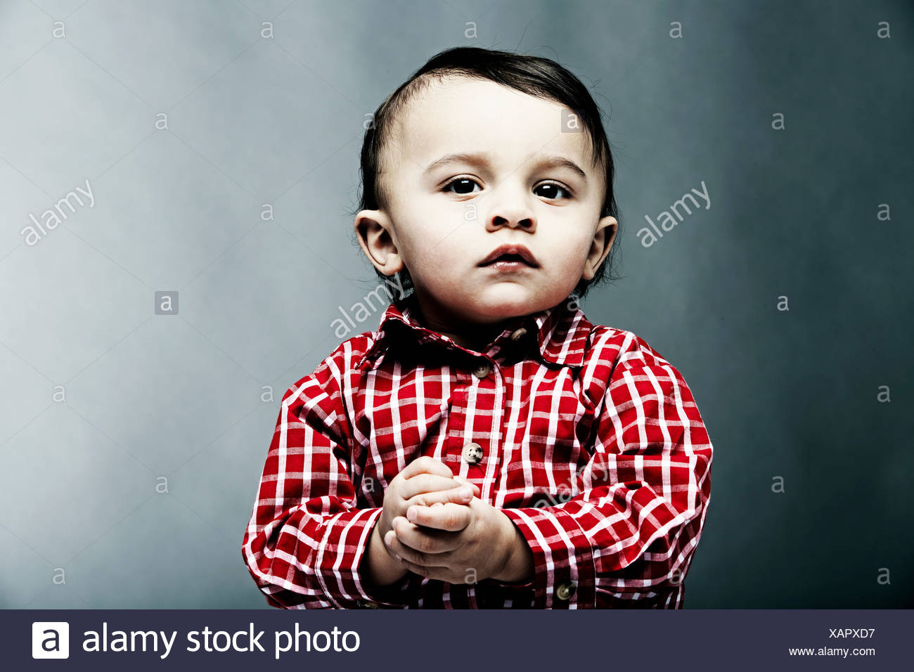 Portrait of baby boy wearing checked shirt - Stock Image