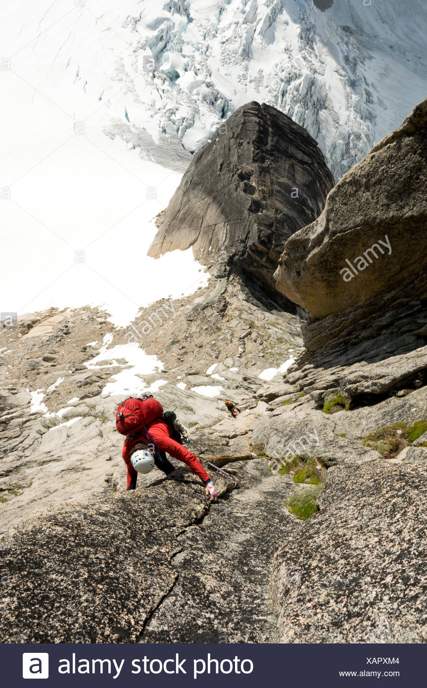 Two climbers ascent Surf's Up, a rock-climbing route on Snowpatch Spire, Bugaboos, British Columbia - Stock Image