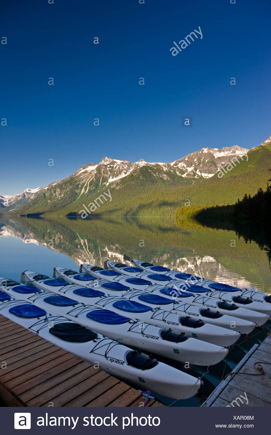 Kayaks lined up at Chilkoot Lake on the south shore, Haines, Southeast Alaska, Summer - Stock Image