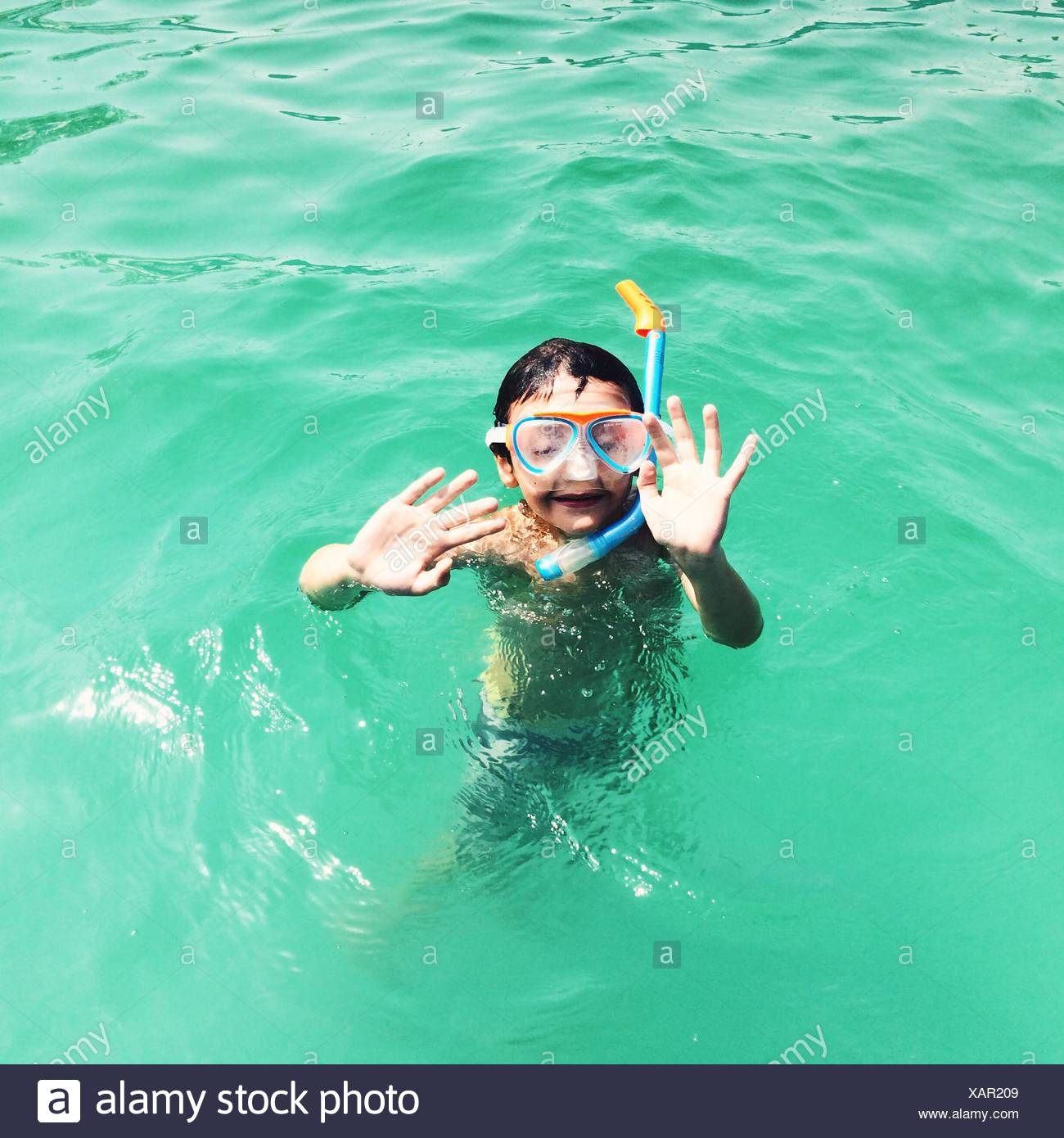 High Angle View Of Boy With Scuba Mask In Swimming Pool - Stock Image