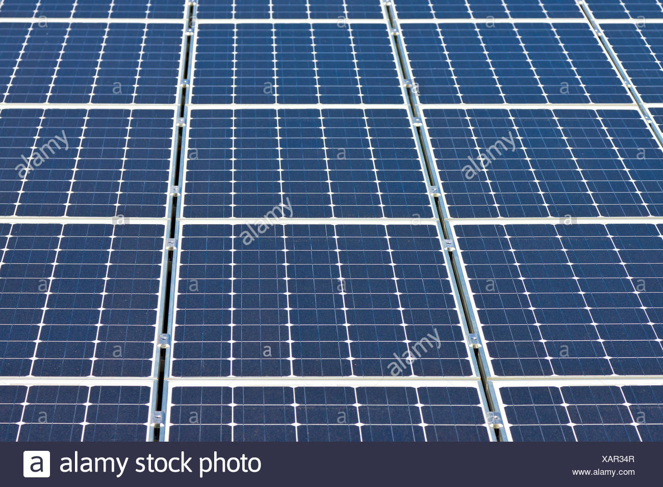 Solar panels on a house roof, photovoltaic - Stock Image