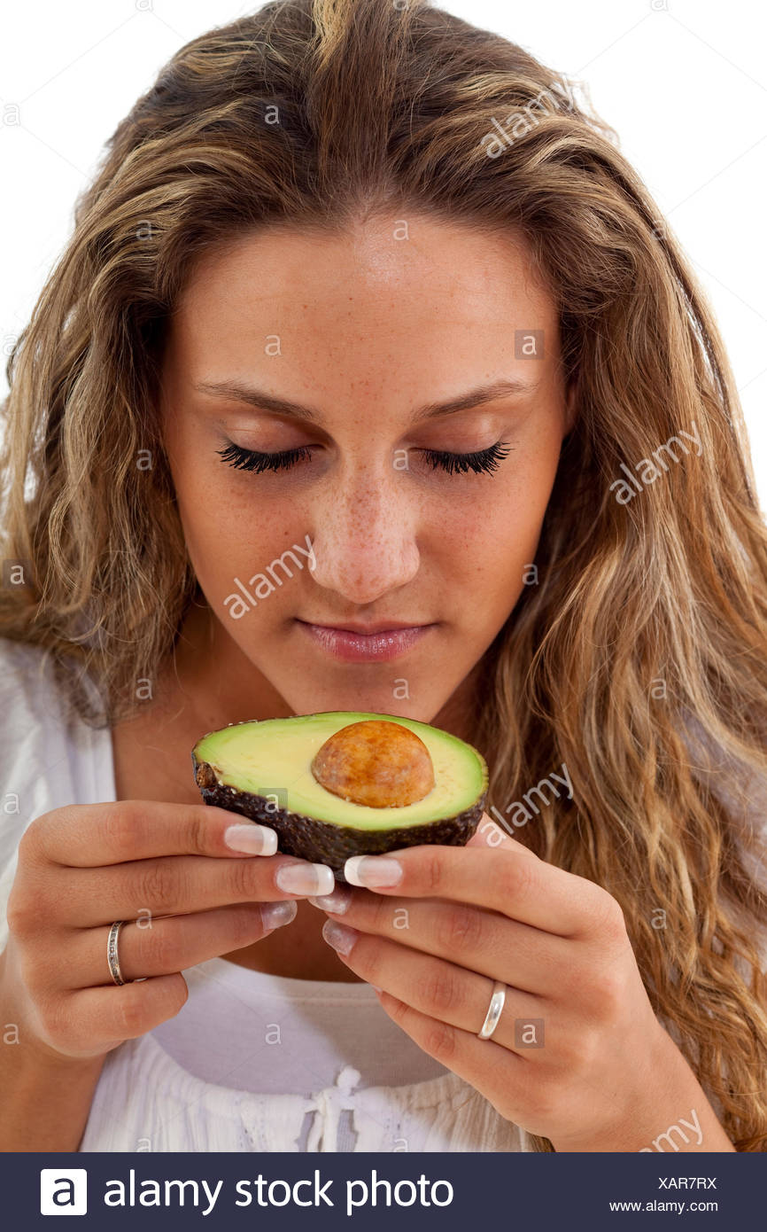 woman smell eighteen young younger avocado woman food aliment portrait - Stock Image
