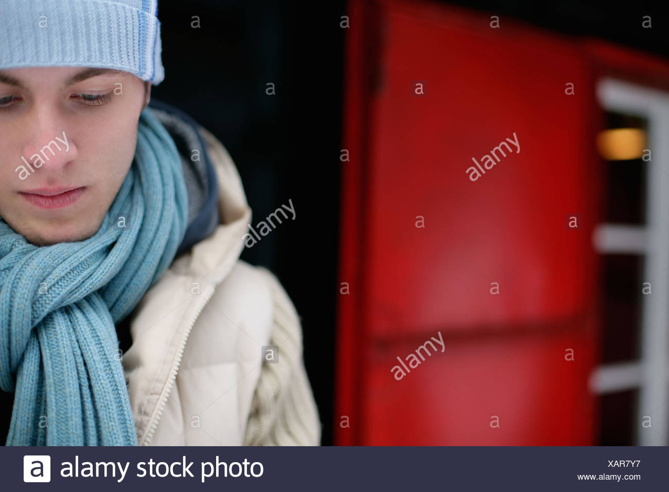 Sullen man in winter clothes - Stock Image