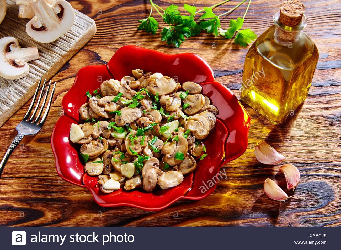 Tapas from Spain champinones garlic mushrooms with potatoes and sausage. - Stock Image