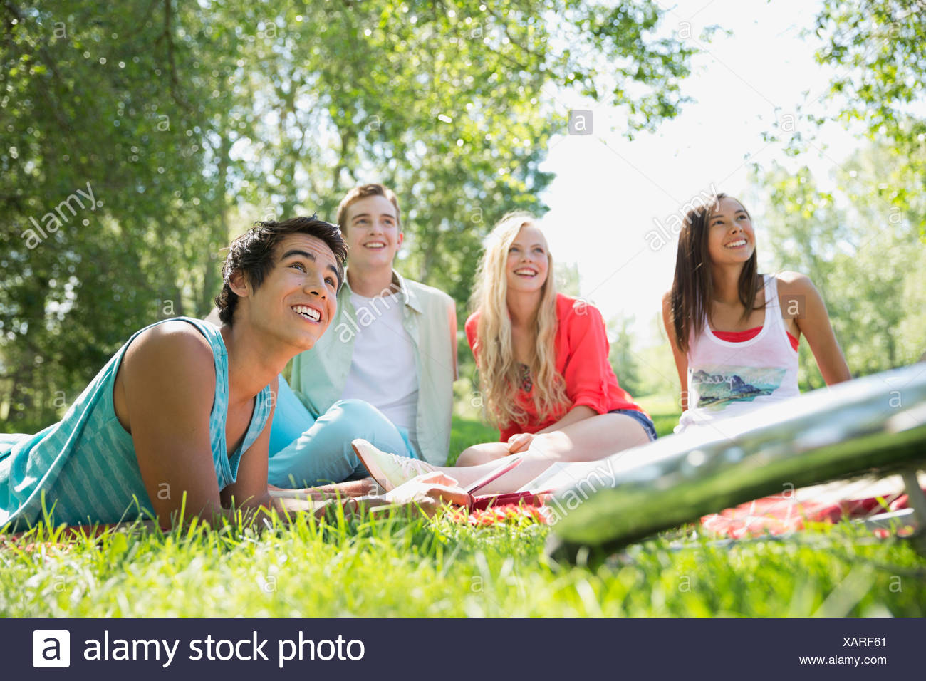 Teenagers hanging out at a park - Stock Image