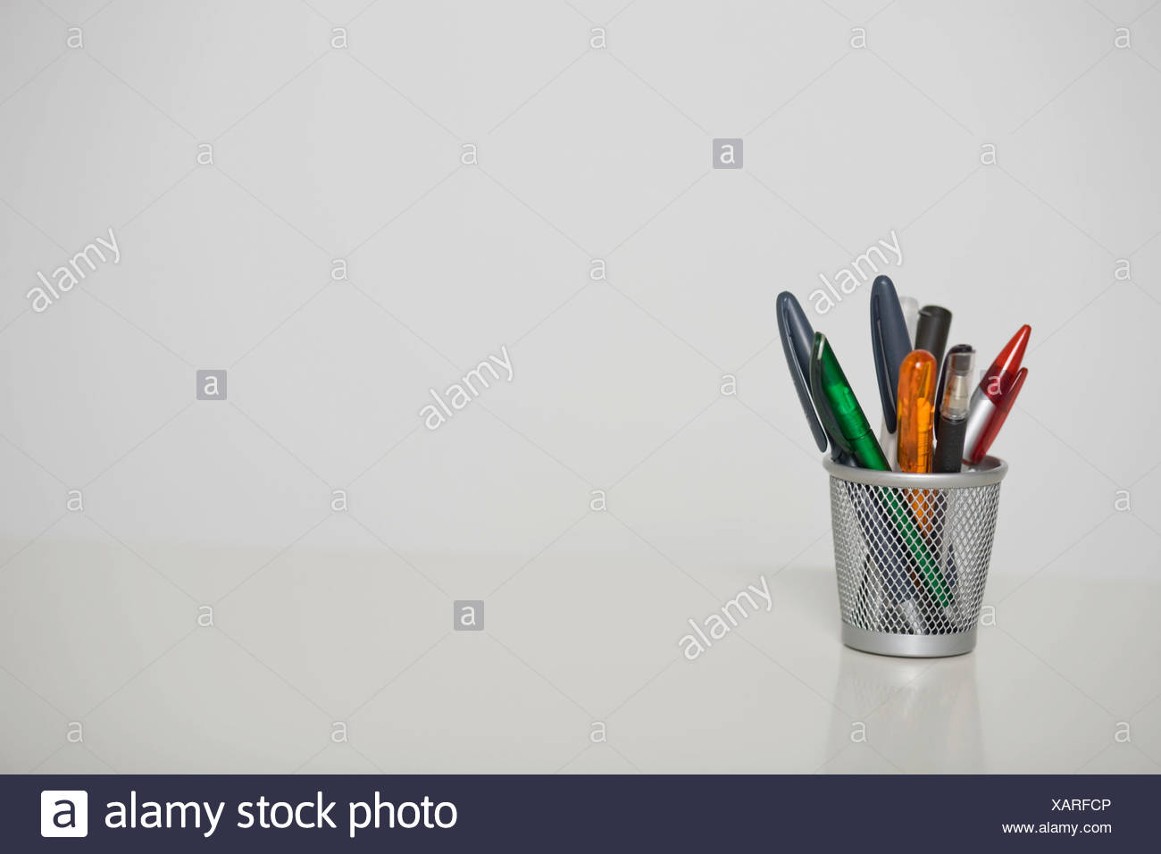 Pens in a pencil holder Stock Photo