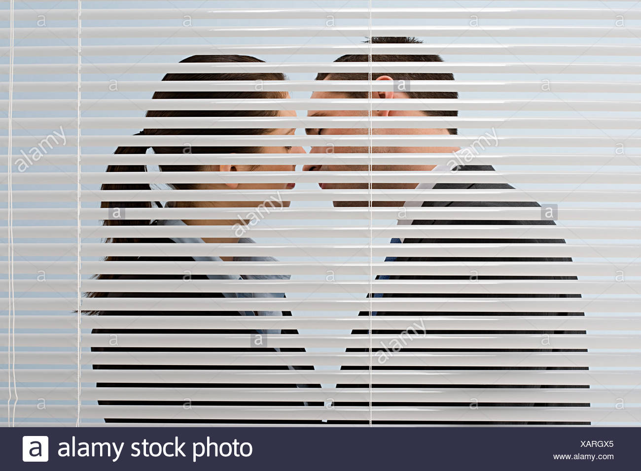 Office workers kissing - Stock Image