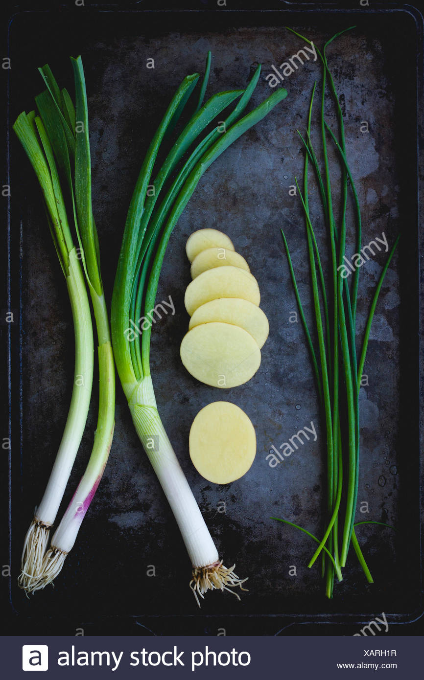 Chives, spring onion and potatoes - Stock Image