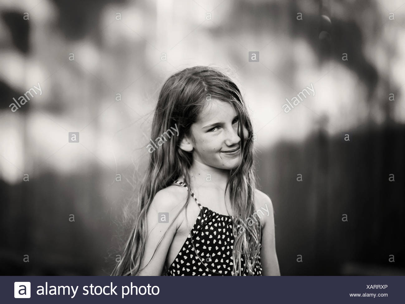 Portrait of a smiling girl - Stock Image