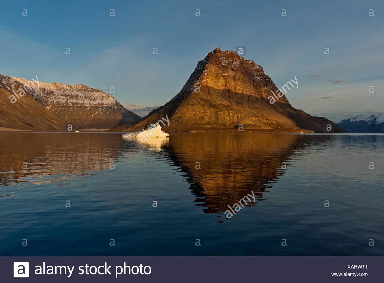 Iceberg in front of Devil's Castle mountain, Kejser Franz Joseph Fjord, Northeast Greenland National Park, Greenland Stock Photo