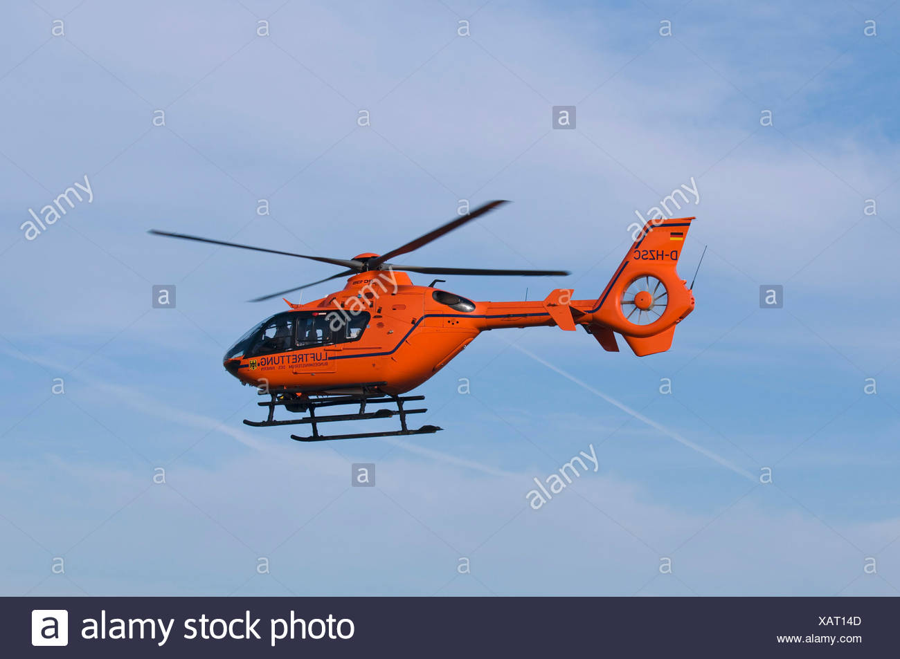 Orange helicopter of the air rescue in flight, rescue helicopter Christoph 3 - Stock Image