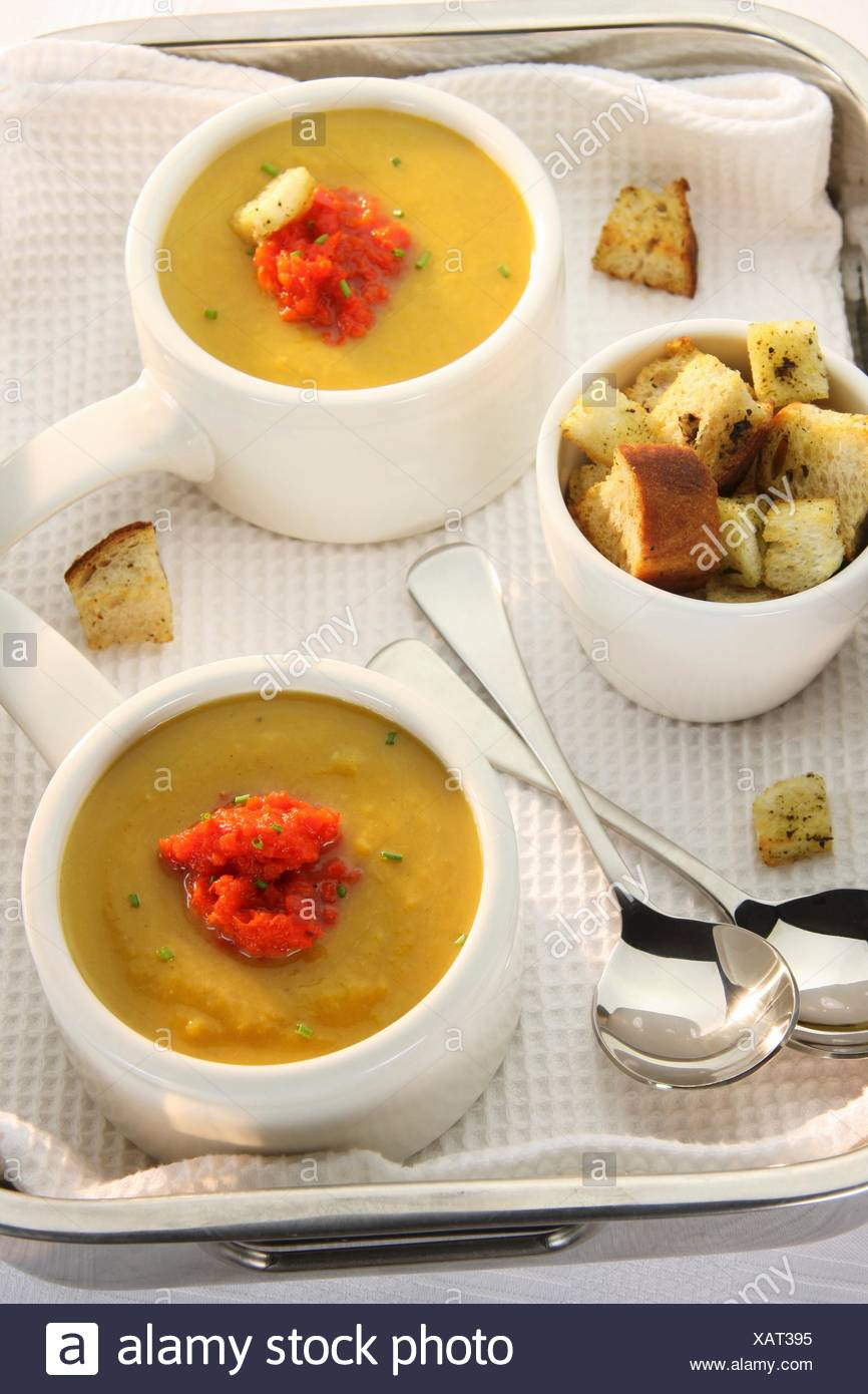 Butternut squash soup with puréed peppers and croutons - Stock Image