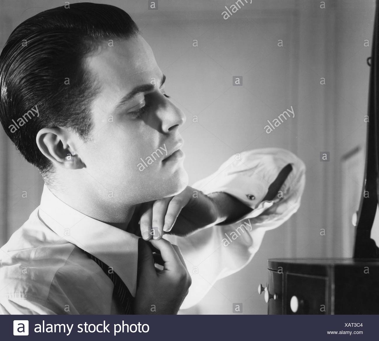 people, men, portrait / half length - 60s, man buttoning up his shirt, 1960s, Additional-Rights-Clearences-NA - Stock Image