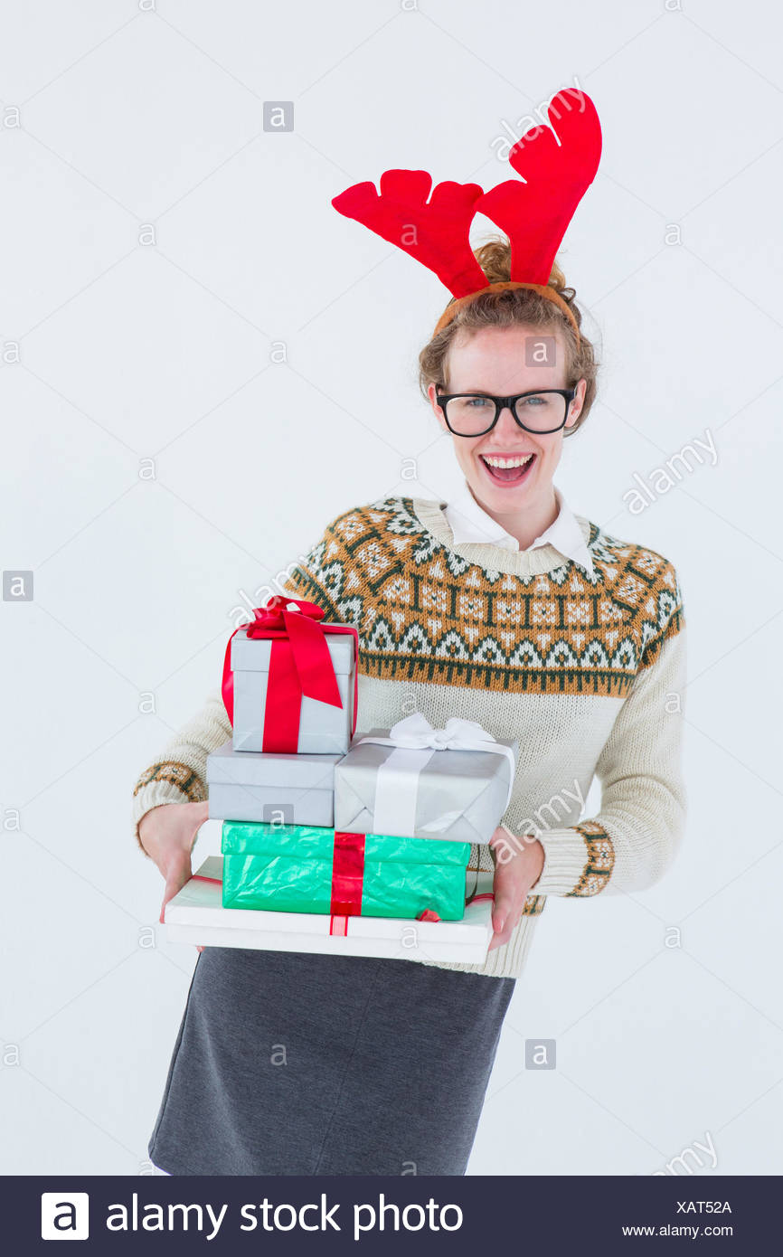 Happy geeky hipster holding presents - Stock Image