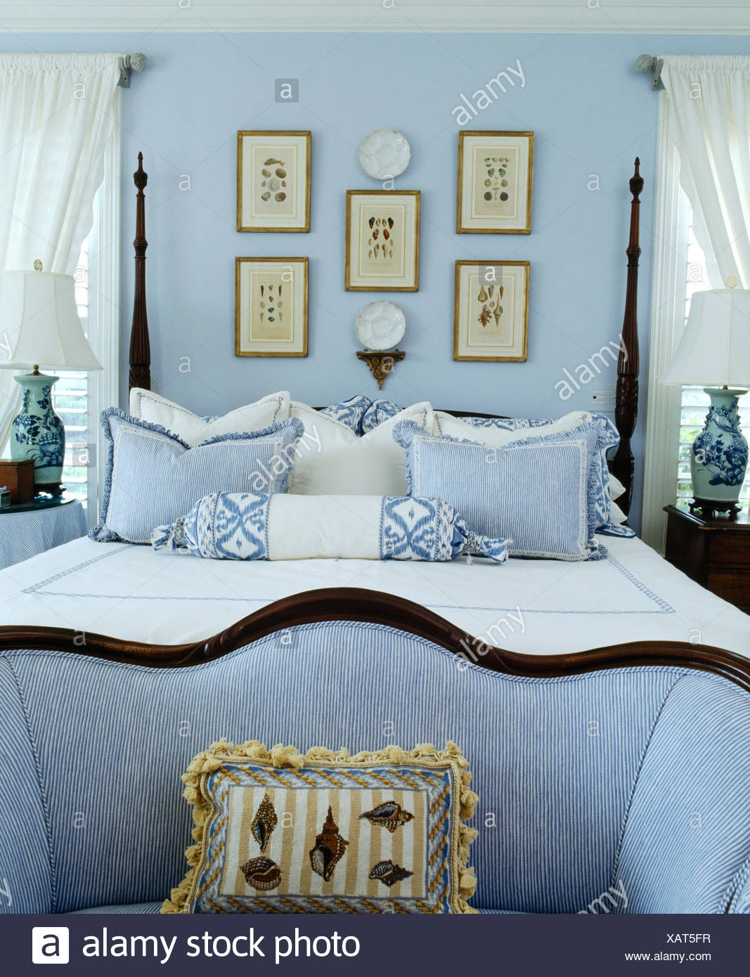 small blue sofa at the foot of bed with turned spindles and blue rh alamy com foot of bed furniture foot of bed table