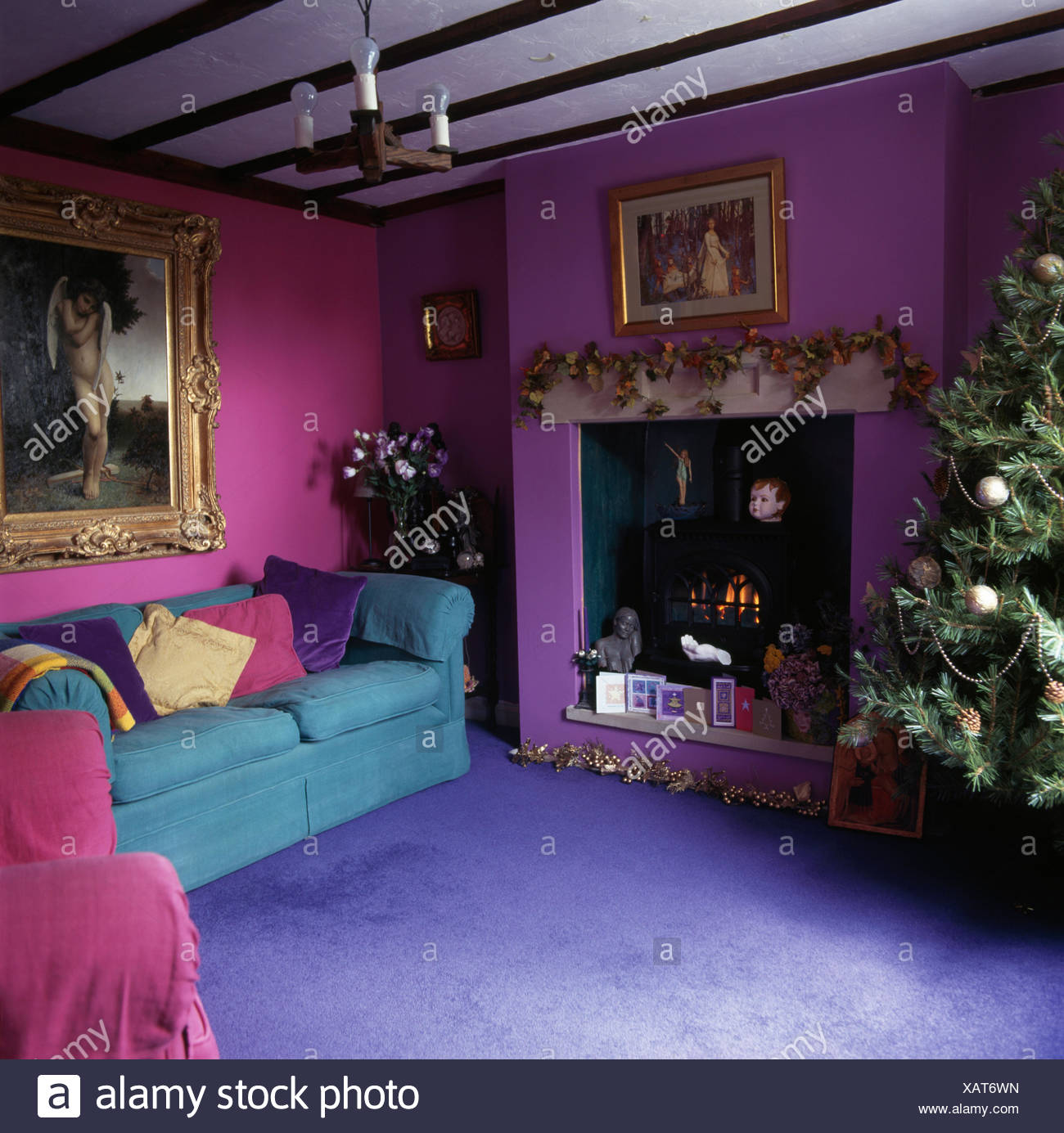 Bright blue carpet and turquoise sofa in purple and pink ...
