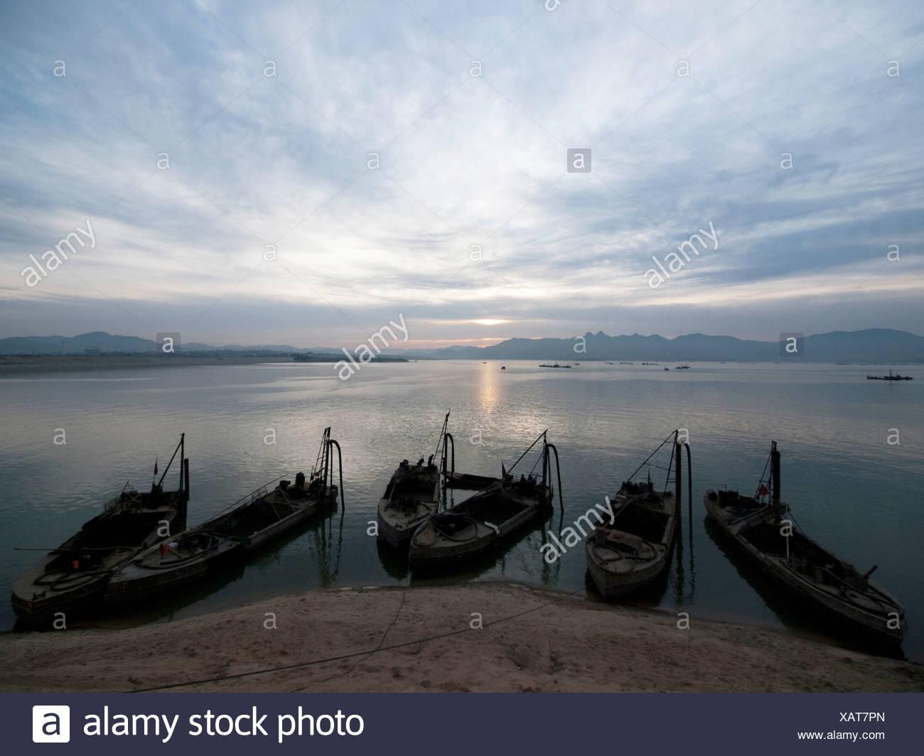 Fishing boats floating on the East China Sea, Qingdao, Shandong , China - Stock Image